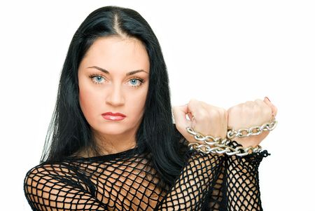 assured: beauty assured woman with chains on wrist  Stock Photo