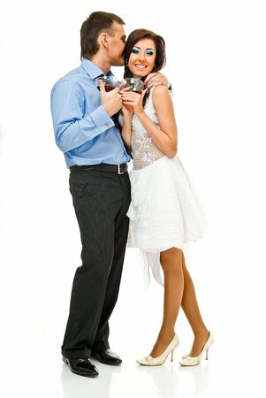 happy young couple with wine glasses on white photo