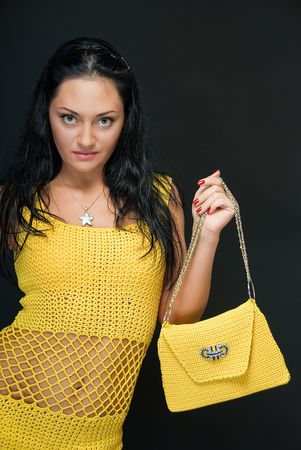 charming young woman in yellow dress on black Stock Photo - 4934409
