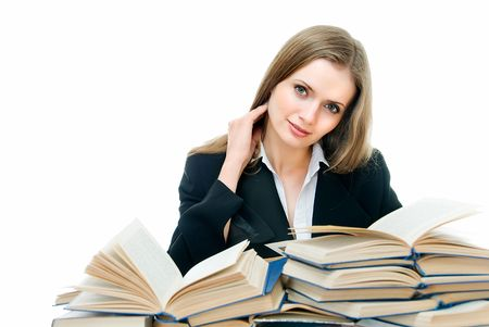 young beauty woman sits among many books