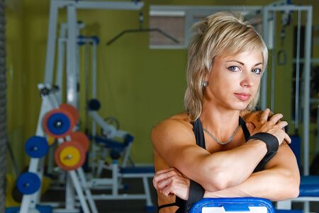 young smiling woman bodybuilder in practice hall photo