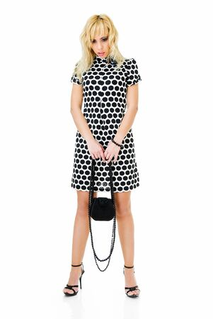 dolly bag: young sad woman in spotted dress on white