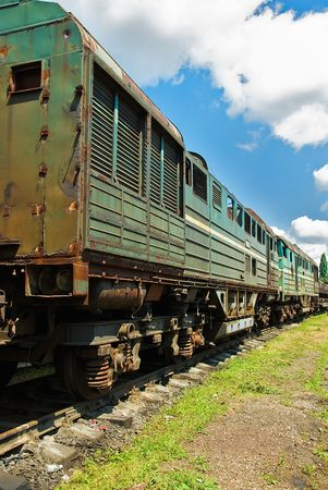 useless: unserviceable trains on rails under blue sky Stock Photo