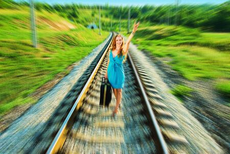 beauty girl following on railway after a train Stock Photo - 5341054
