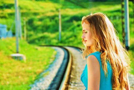 beauty charming pretty girl on the train tracks Stock Photo - 5405035