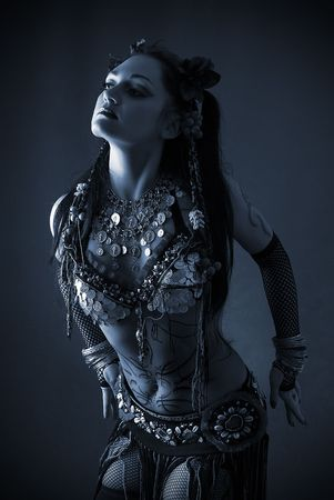 young beautiful tribal dancer woman in black and white with blue tint