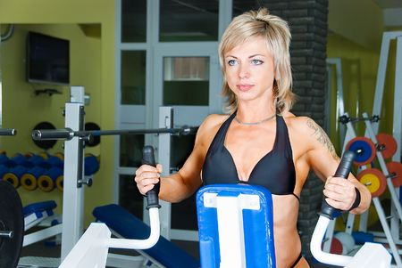 young pretty woman bodybuilder has exercise photo