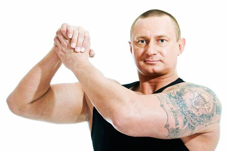 russian man: athletic man shows sign of truce on white background