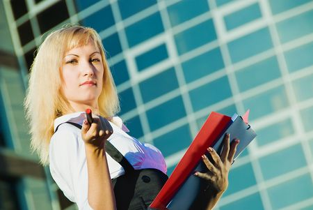 young pretty business woman on modern building background photo