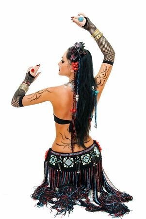 alluring lines of sitting tribal dancer on white