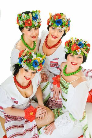 four ukrainian young women dancers on white photo