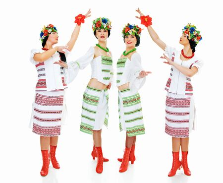 four dancing ukrainian young women on white photo