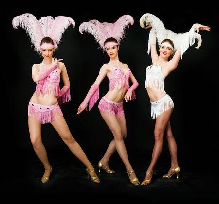 three young women latino dancers on black 写真素材