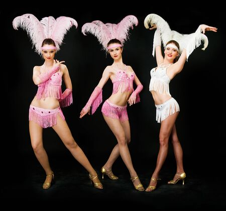 three young women latino dancers on black Banque d'images