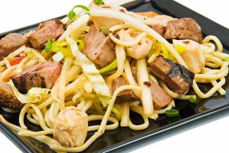 boned: noodles and three kinds of meat on black plate