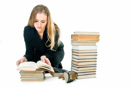 young pretty business lady on the floor among books photo