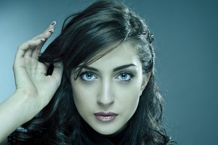 girl with gray eyes: face of beauty model in cold colours
