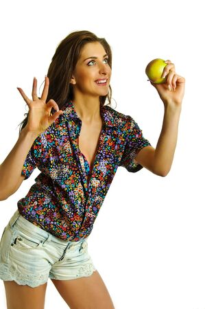 blinders: beauty girl with apple in hand on white background Stock Photo