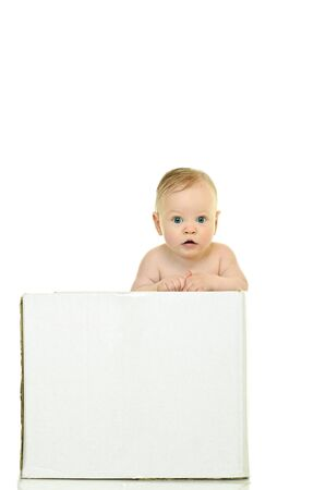 eight month baby holds on to the white box Stock Photo - 6928726