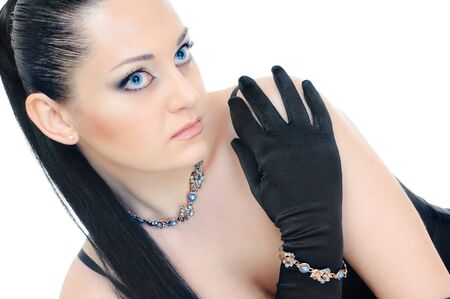 portrait of brunette with blue eyes and blue necklace on white photo