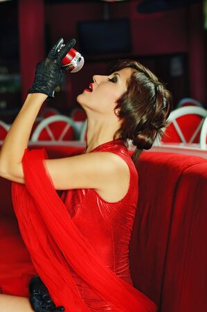 beautiful singer girl with microphone in red colours at club photo