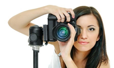 sexy photo: portrait of beauty brunette with camera on white Stock Photo