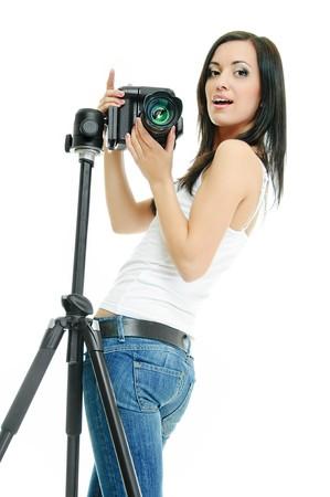 portrait of beauty brunette with camera on tripod photo