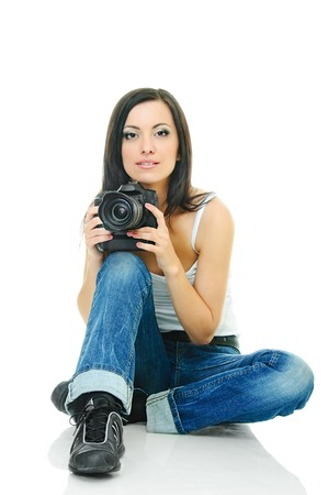 portrait of beauty brunette with camera on white photo