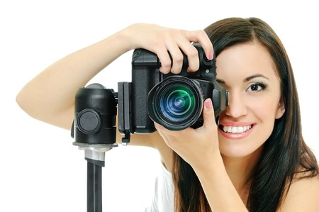 sexy girl posing: portrait of beauty brunette with camera on white Stock Photo
