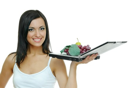 beauty brunette with laptop and fruits on white Stock Photo - 7894120