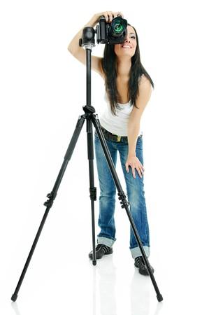 portrait of beauty brunette with camera on tripod