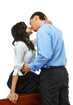 young couple hugging kissing: young love couple embraces on white background
