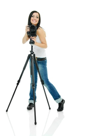 portrait of beauty brunette with camera on tripod photo