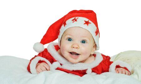 little boy in santas suit on white
