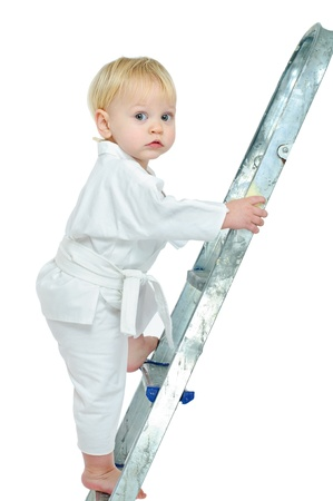 little boy in kimono on step ladder and white background photo