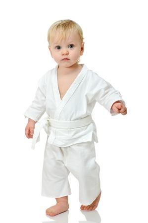 little boy in kimono on white background