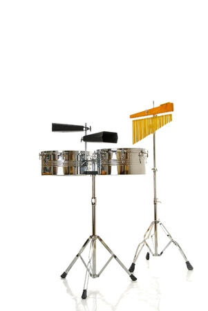 two cowbells and timbales on white background