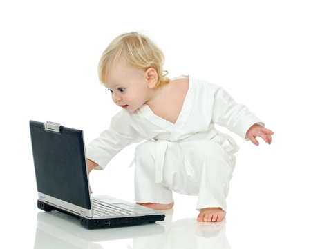 little boy in kimono about laptop on white background Stock Photo