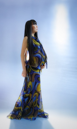 transparent dress: asian pregnant woman in transparent dress on blue background with radiance  Stock Photo