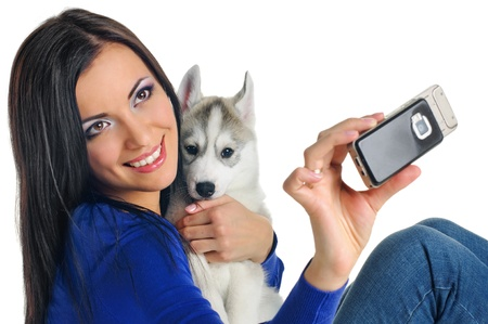 woman portrait with puppy of siberian haski on white photo