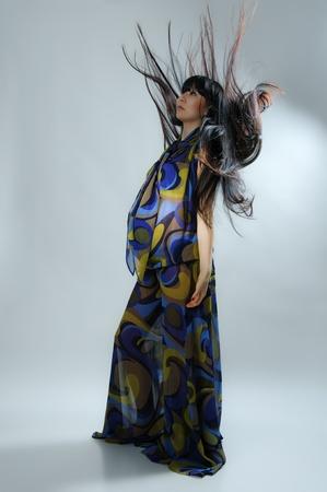 transparent dress: asian pregnant woman in transparent dress on grey
