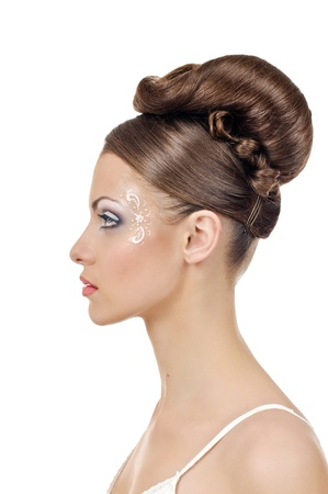 portrait of beautiful girl bride with coiffure and make up on white