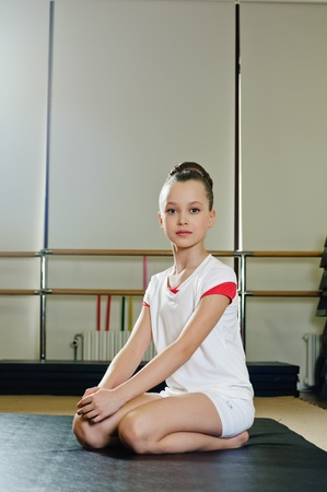female gymnast: portrait of young beauty gymnast in gymnasium Stock Photo
