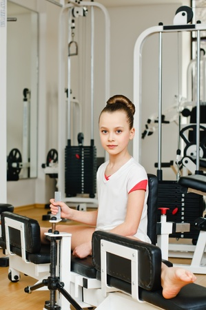 on the skids: portrait of young beauty gymnast in gymnasium