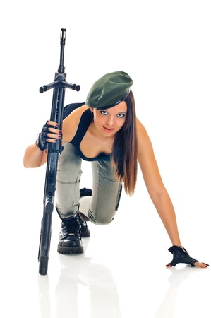 young beauty girl with machine-gun on white background photo