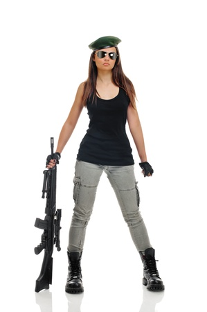 paintball: young beauty girl with machine-gun on white background