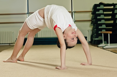 skids: portrait of young beauty gymnast in gymnasium