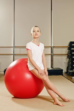barefoot teens: portrait of young beauty gymnast in gymnasium on the ball