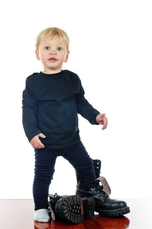 two years old boy in big shoes on white Stock Photo - 10409470