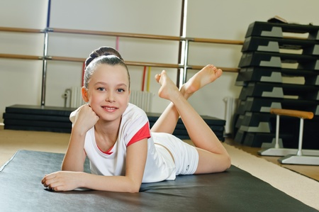 portrait of young beauty gymnast in gymnasium Stock Photo
